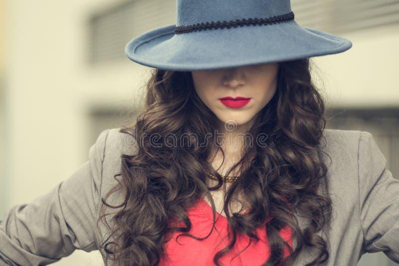 Seductive glamorous brunette wearing stylish clothes posing stock images