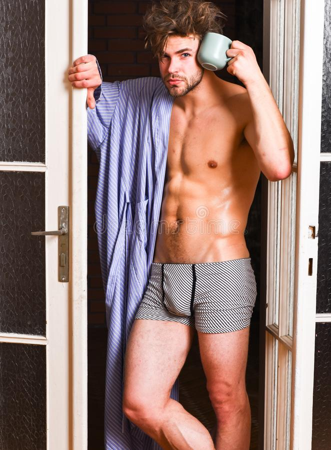 Seductive lover full of desire. macho tousled hair coming out bedroom door. Man lover near door. bachelor. Lover concept. That was great night. Guy attractive royalty free stock image