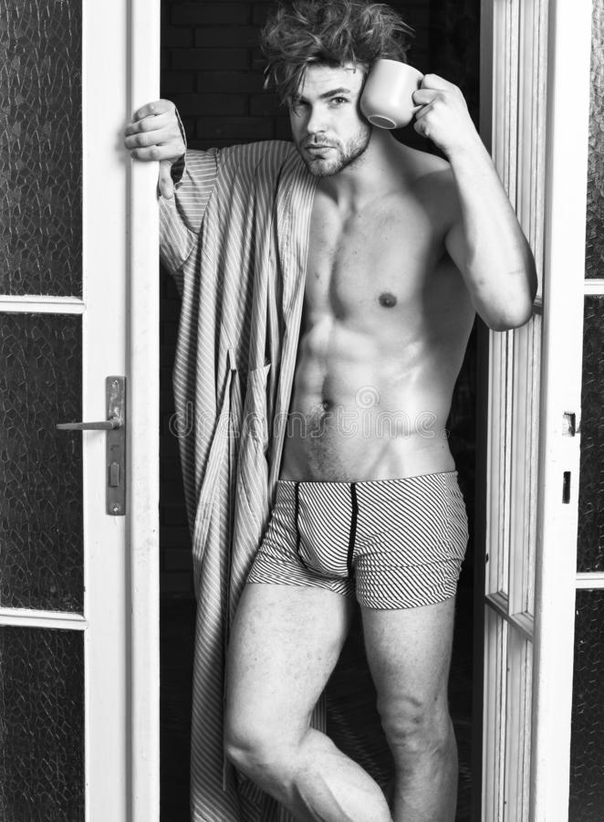 Seductive lover full of desire. Sexy macho tousled hair coming out bedroom door. Man lover near door. Sexy bachelor. Lover concept. That was great night. Guy royalty free stock photo