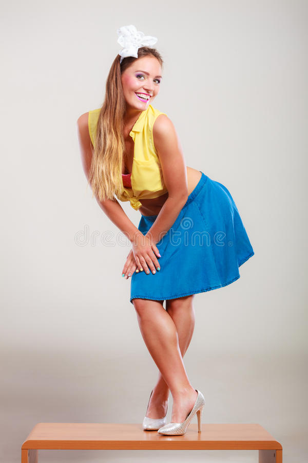 Seductive pin up woman girl dancing on table. royalty free stock image