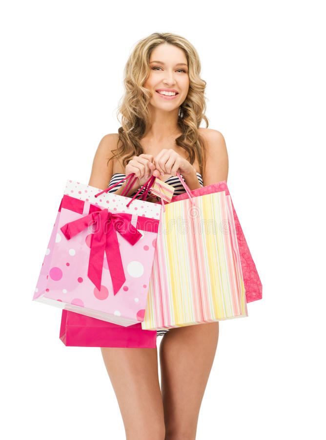 Download Seductive Woman In Bikini With Shopping Bags Stock Image - Image of female, gifts: 25261639