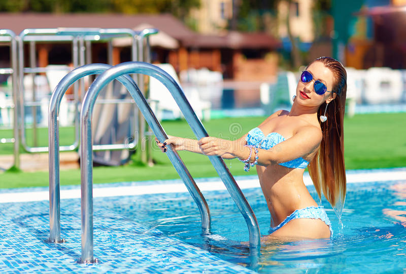 Seductive woman coming out of pool. Pretty woman coming out of pool royalty free stock photos