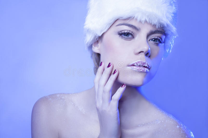 Seductive woman in cool blue winter tones royalty free stock image