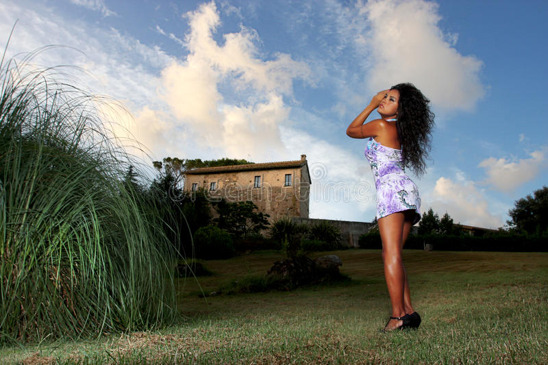 Seductive woman in the country stock image