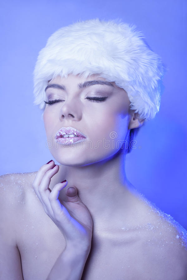 Seductive woman with a dreamy expression stock image
