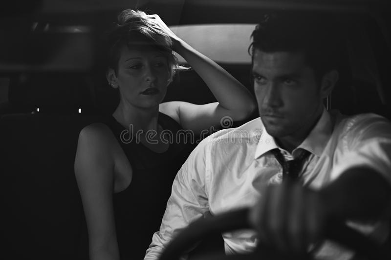 Seductive woman and driver on a car royalty free stock photography