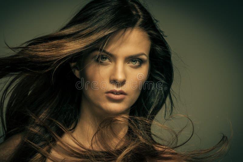 Seductive woman. Seductive fatal brunette woman with long hair royalty free stock photos