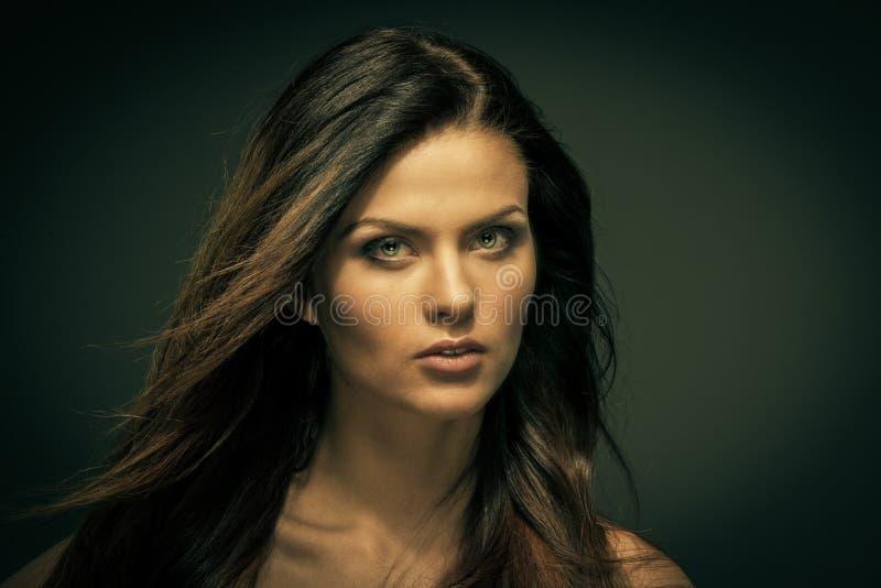 Seductive woman. Seductive fatal brunette woman with long hair stock photography