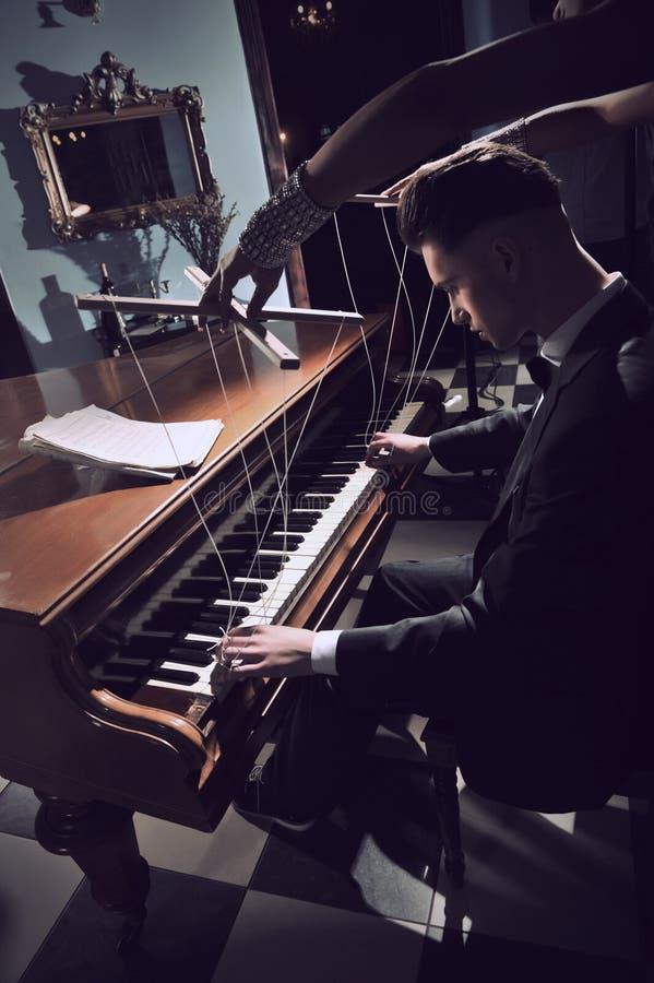 Seductive woman on the piano royalty free stock photo