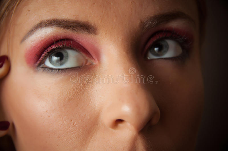 Seductive woman with red smoky eyes makeup royalty free stock photo