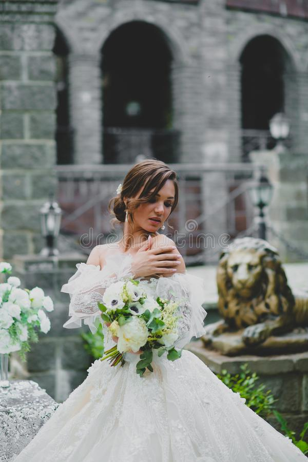 Seductive young bride posing on the territory of country hotel stock image