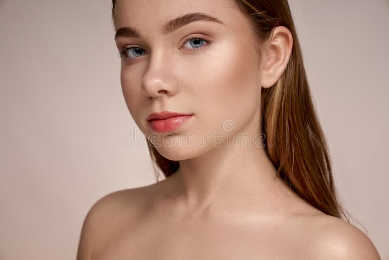 Seductive, young girl with perfect skin, plump lips. stock images