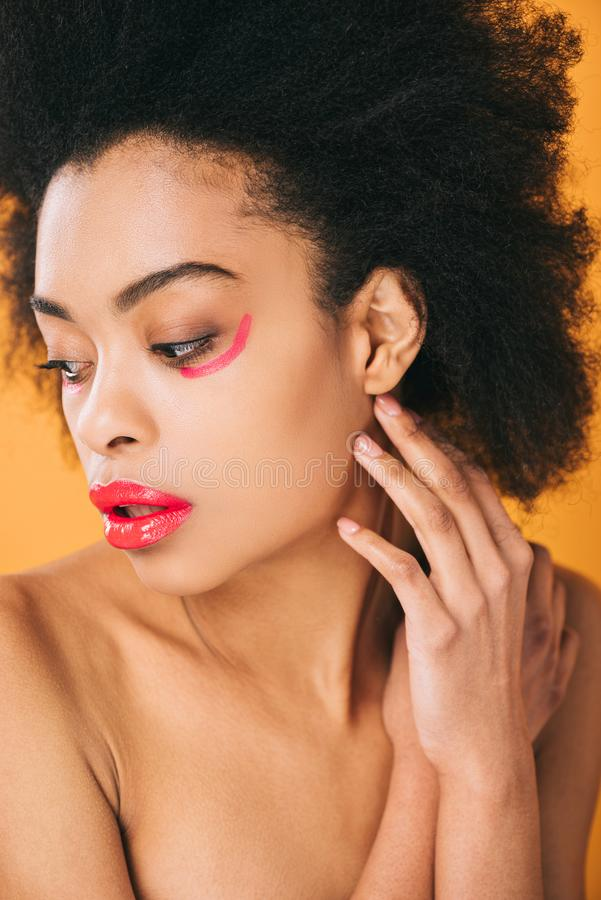 seductive young woman with creative red makeup royalty free stock image