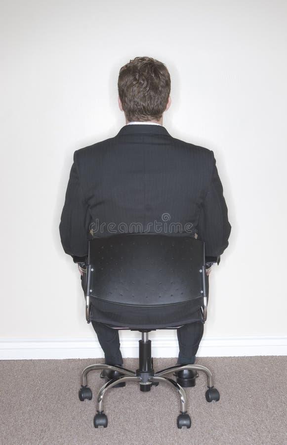 Seduta dell'uomo d'affari immagini stock