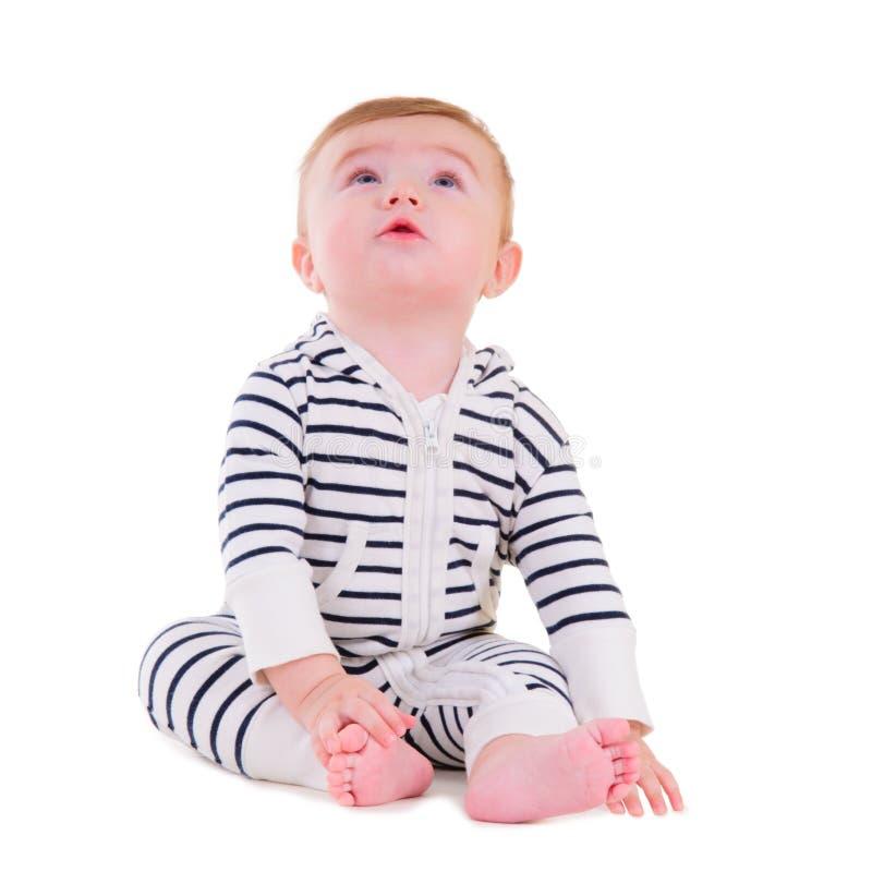 Seduta sorridente del bambino fotografie stock libere da diritti
