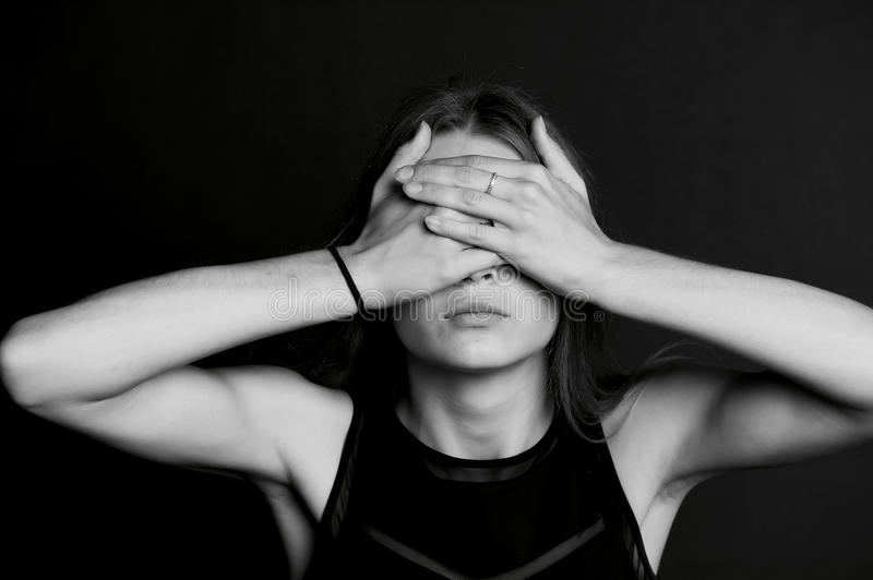 See no evil. The girl closes your eyes. stock photo