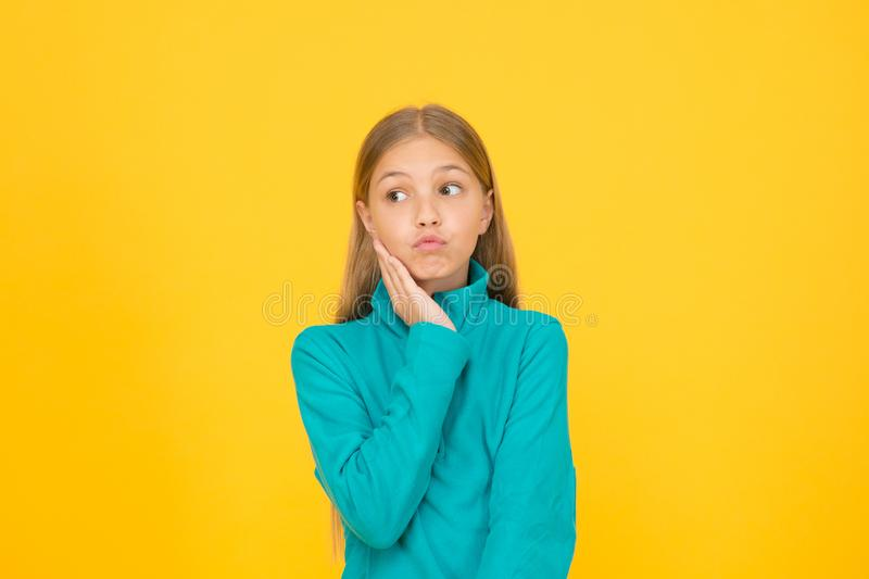See your dentist as soon as possible. Little child suffer from toothache yellow background. Anti toothache remedy royalty free stock photos