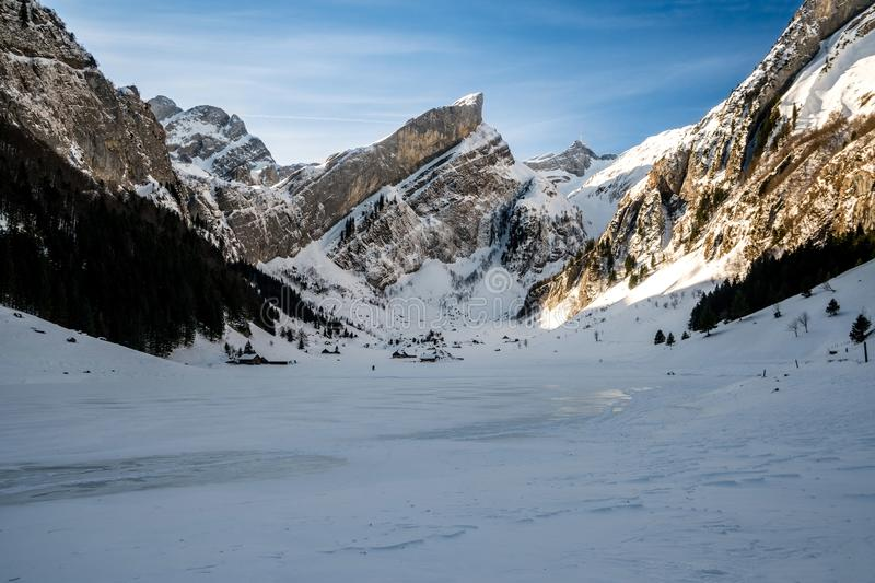 Seealpsee, swiss mountains during winter royalty free stock image