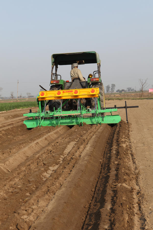 SEED DRILL AGRICULTURAL MACHINE. ITS IS AGRICUTURAL MACHINE USED FOR SOWING SEED IN THE FIELD FOR CULTIVATION royalty free stock photography