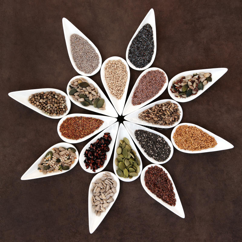 Seed Food Platter. Large seed food selection in porcelain dishes over lokta paper background royalty free stock images