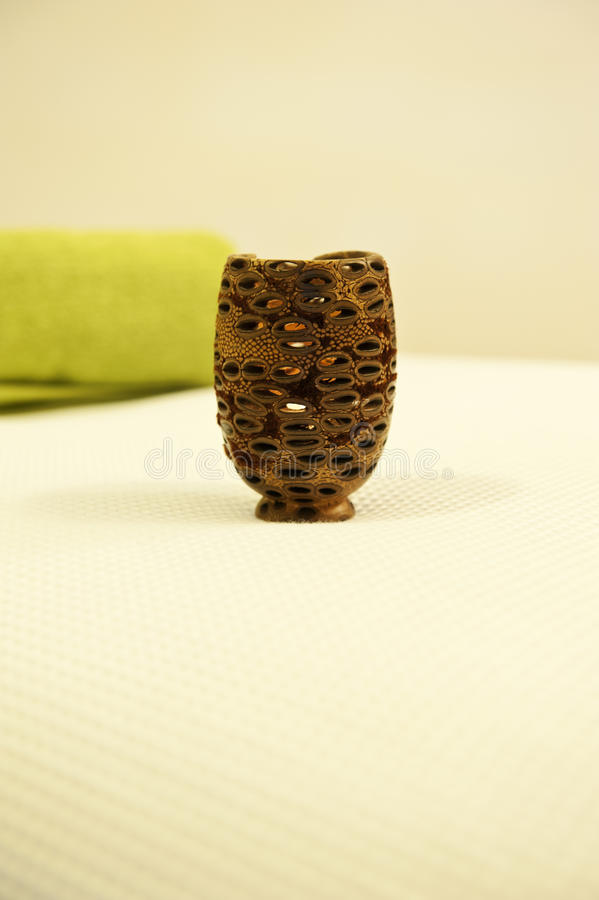 Seed pod cancle. A seed pod fashioned into a candle holder at a beauty clinic stock photos