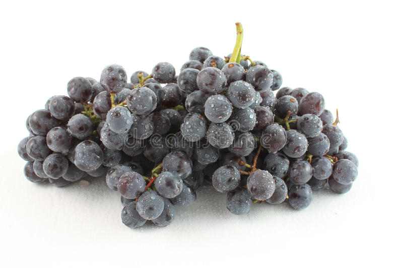 Seedless Coronation Grapes. Bunch of Seedless Coronation Grapes, on a white background with water drops royalty free stock photo