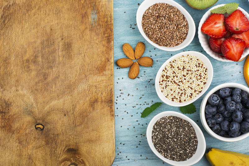 Seeds of flax, chia, quinoa: modern superfoods, healthy food ingredients, diets, breakfast. Top View. royalty free stock images