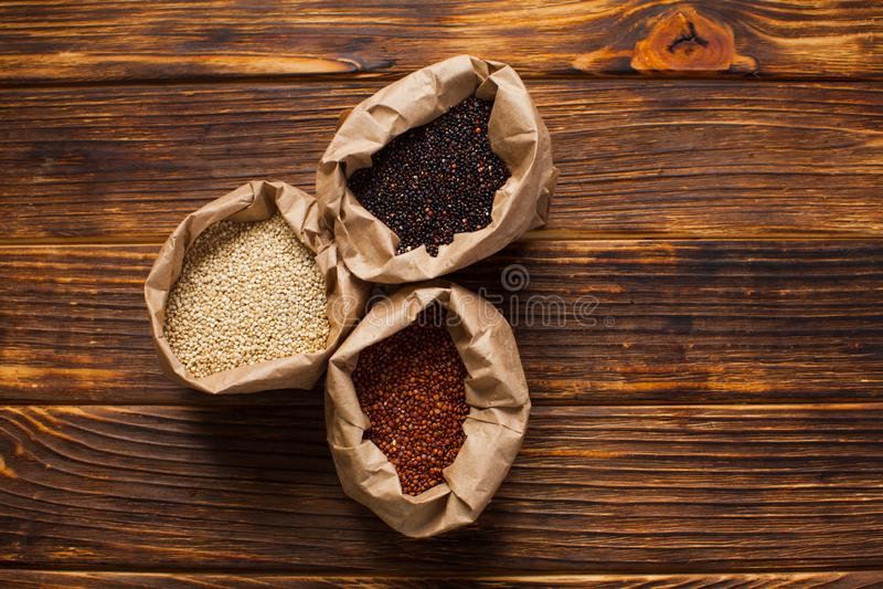 Seeds of white, red and black quinoa - Chenopodium quinoa stock images