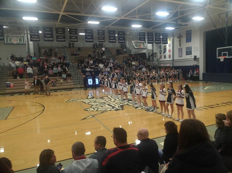 Seeger and Lafayette Central Catholic cheerleaders stand together during national anthem. Prior to the start of girls sectional championship game between Seeger stock photo