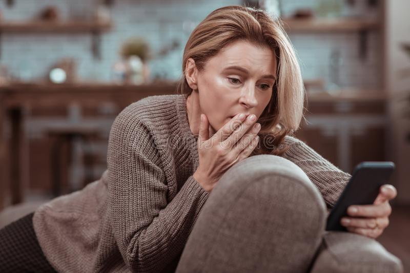 Woman Feeling Emotional After Seeing Message From Husband Stock