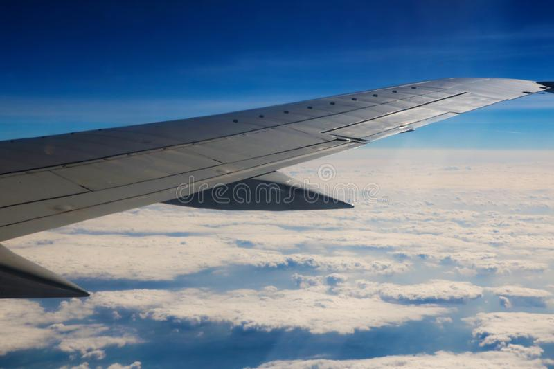 Seeing the plane`s wing and the outer view from the window.  stock photo