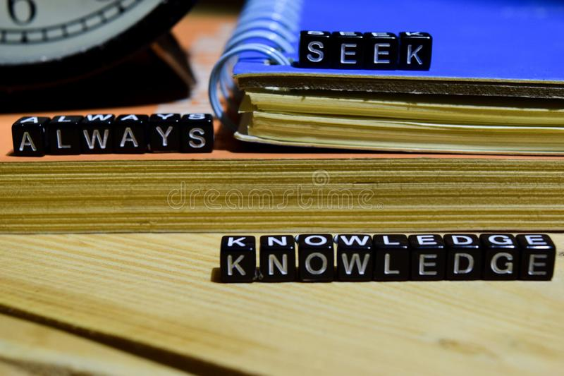 Always seek knowledge written on wooden blocks. Education and business concept stock image