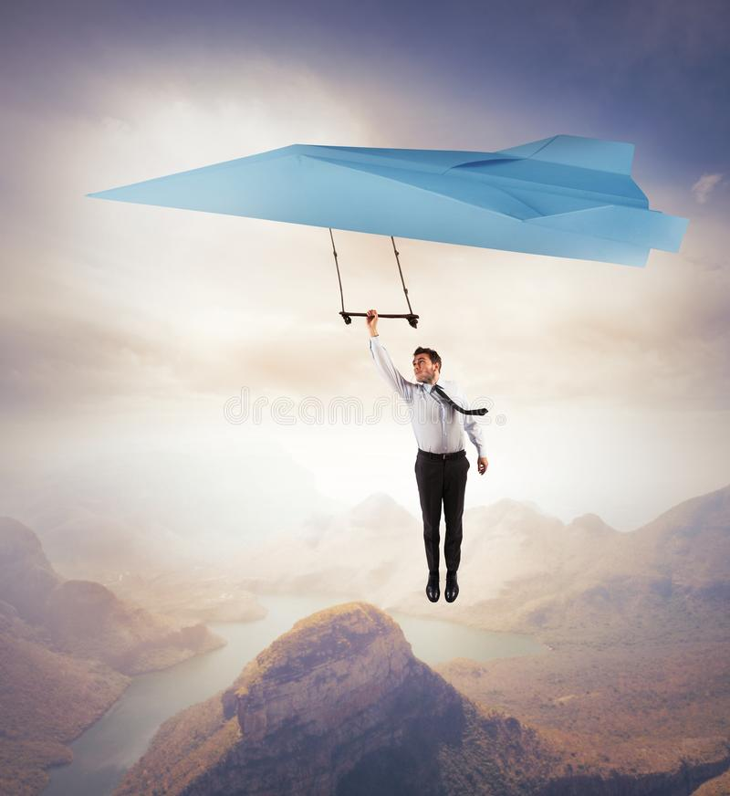 Seek new business. Businessman seeks for new business with a paper airplane royalty free stock photography