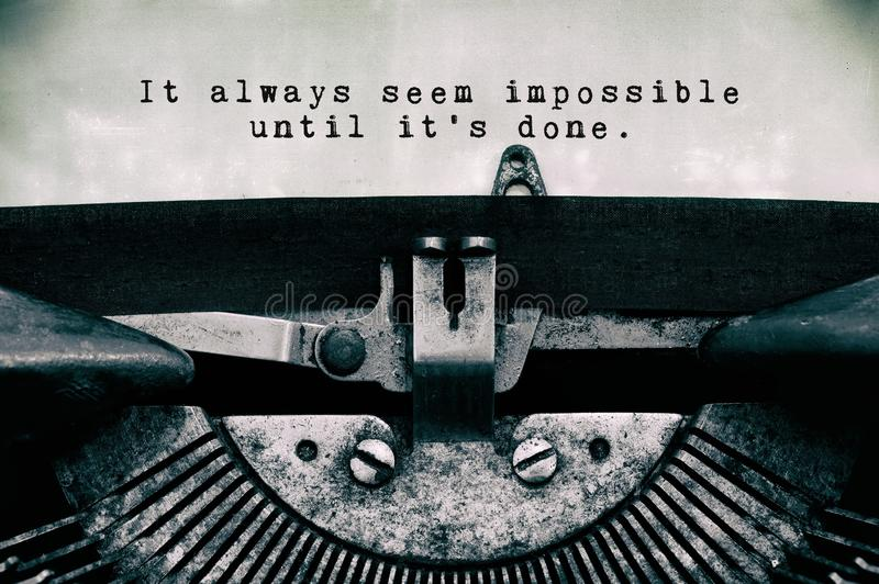 It always seem impossible until it`s done words life quote stock photos
