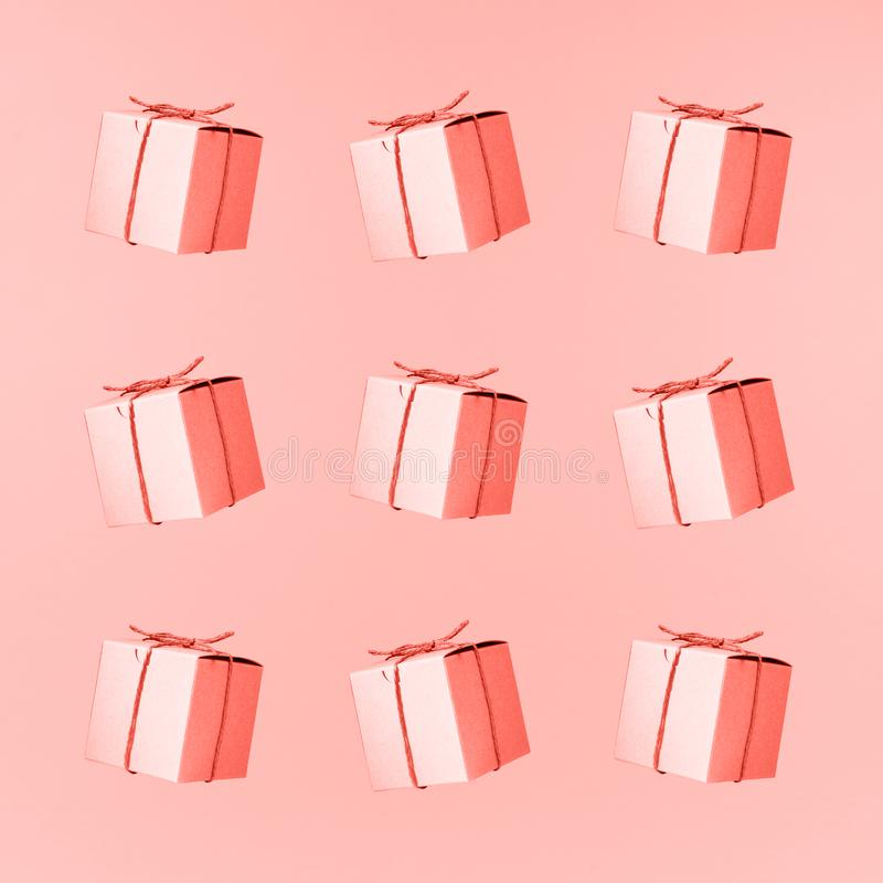Seemless pattern of craft cardboard gift boxes on the solid pink background. Holiday and gift concept. Pop art slyle . Living stock photos
