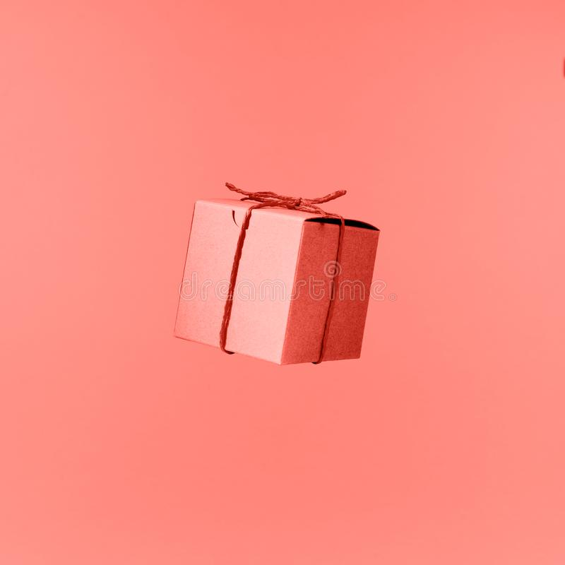 Seemless pattern of craft cardboard gift boxes on the solid pink background. Holiday and gift concept. Pop art slyle . Living royalty free stock photos
