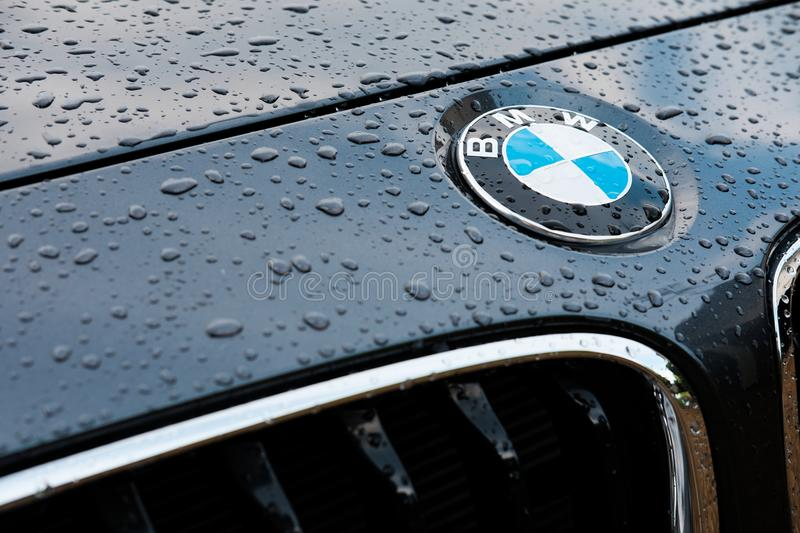 Front view of prestige, german made sports car showing detail of the grille and name badge. Seen after a heavy downpour, droplets of water can be seen on the royalty free stock images