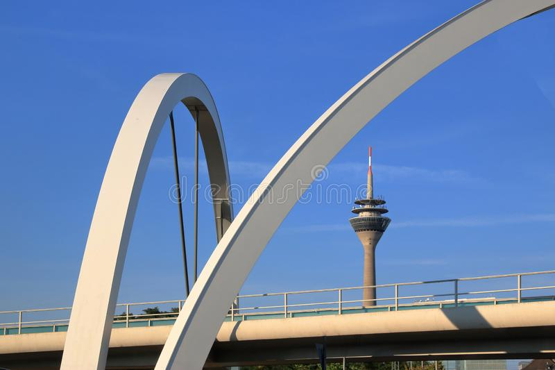 Seen Rhine Tower Dusseldorf in a different perspective by bridge to the port royalty free stock images