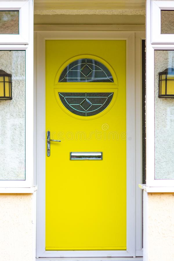 Bright & light modern canary yellow front door royalty free stock photos