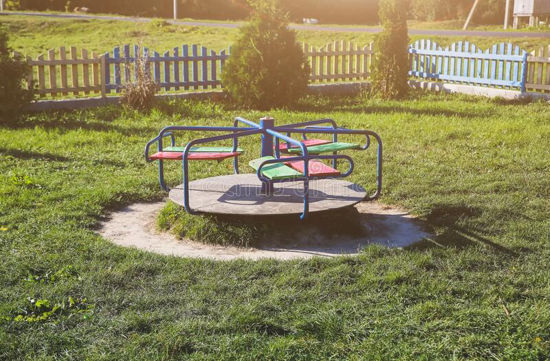 Seesaw on children playground. Outdoors games for kids. Summer day.  royalty free stock photography