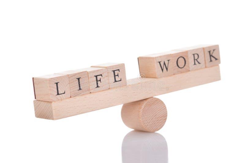 Seesaw representing imbalance between life and work stock photos
