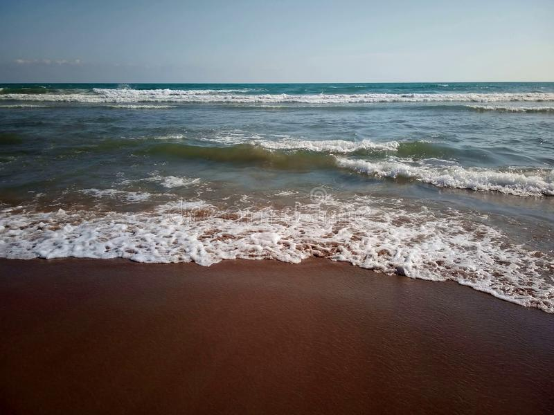 Seething seascape with sandy beach royalty free stock images