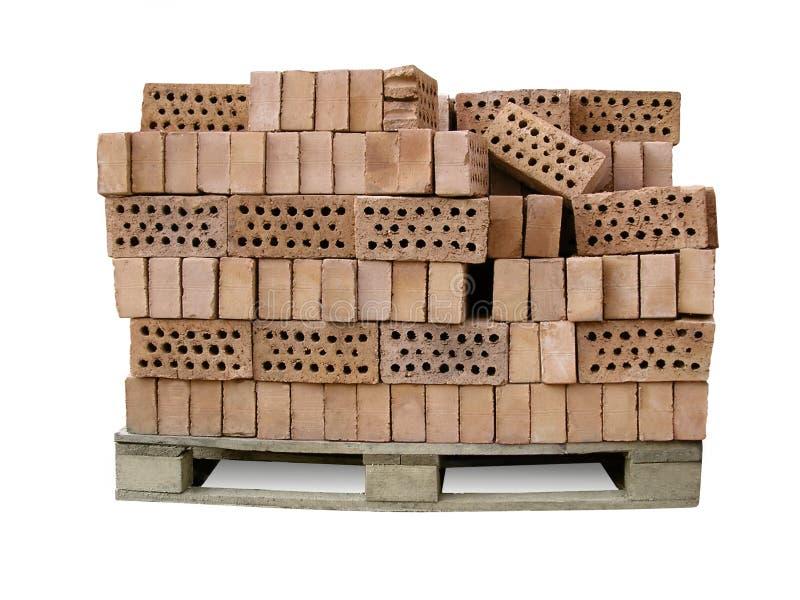 Segment de mémoire des briques sur une palette - approvisionnements de construction photographie stock