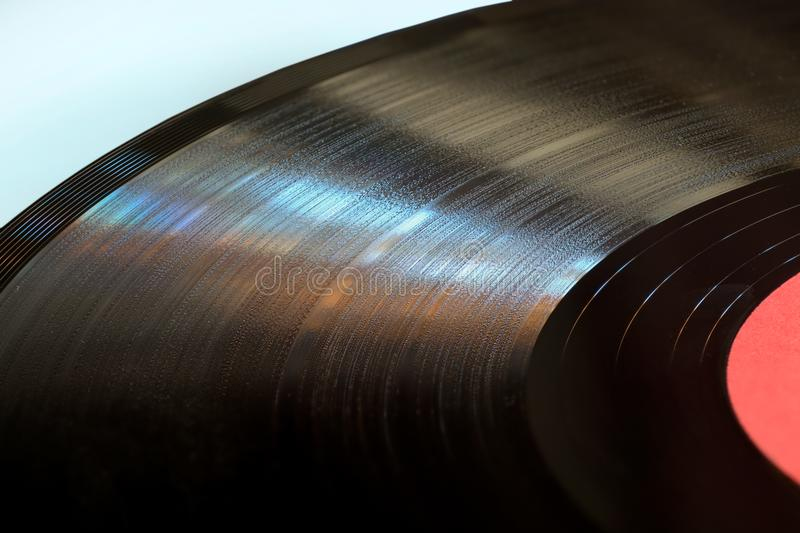 Segment of vinyl record with label close up. royalty free stock photo