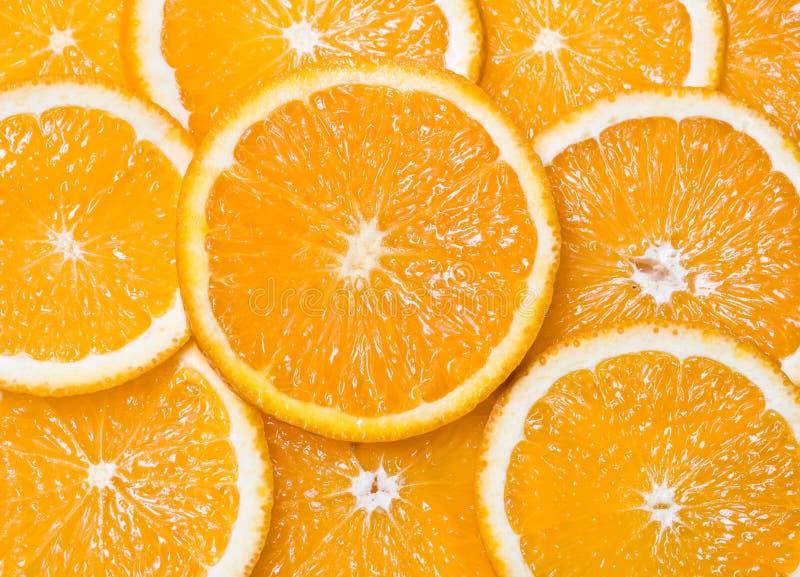 Segmenti arancioni del primo piano come ambiti di provenienza fotografia stock libera da diritti