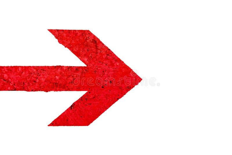 Segnale di direzione rosso della freccia con struttura di pietra lucidata con le imperfezioni e le crepe fotografia stock libera da diritti