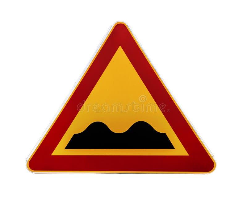 Segnale stradale d'avvertimento triangolare rosso e giallo con un avvertimento di una strada irregolare avanti immagine stock libera da diritti