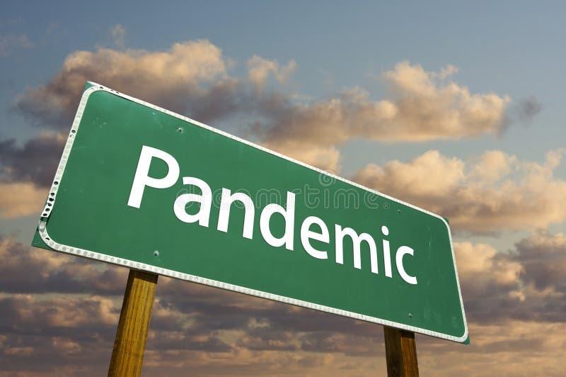 Segnale stradale verde pandemico immagine stock libera da diritti