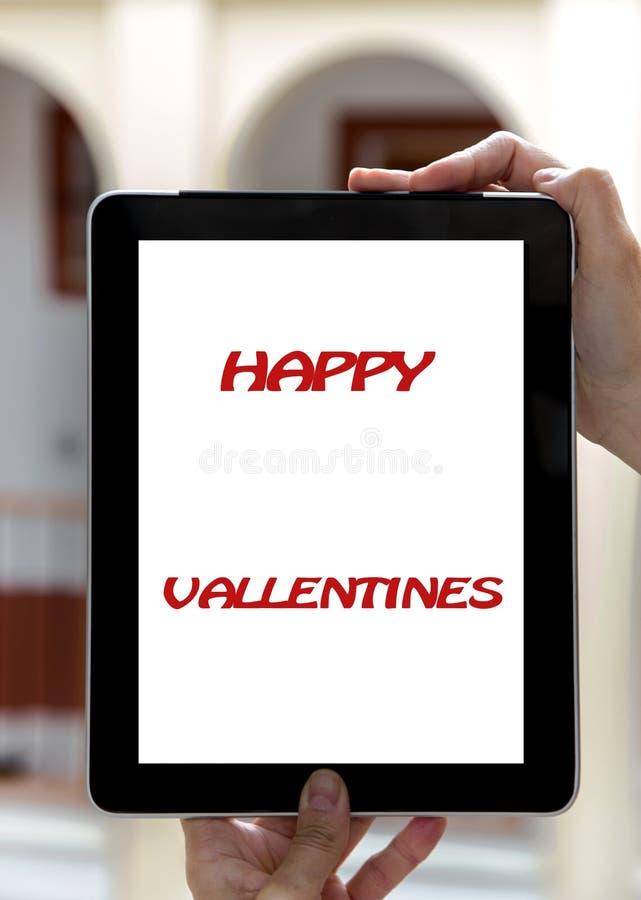 Segni di San Valentino di concetto della compressa: Segni del San Valentino o fotografia stock libera da diritti
