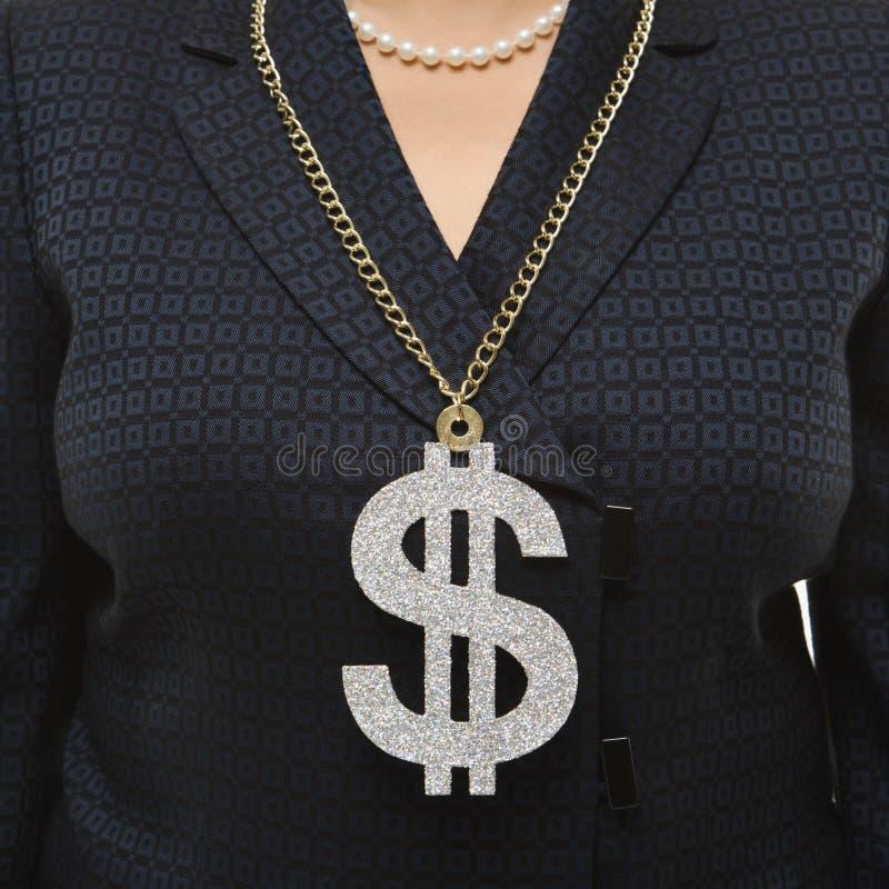 Segno da portare del dollaro della donna di affari. fotografia stock